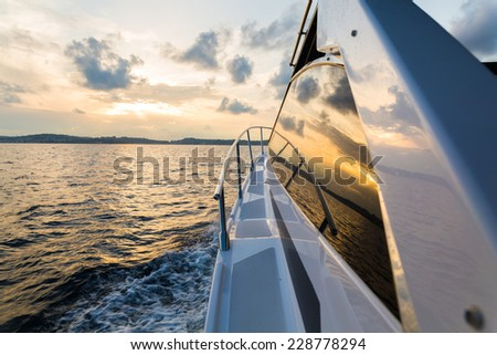 Boat at sunset - stock photo