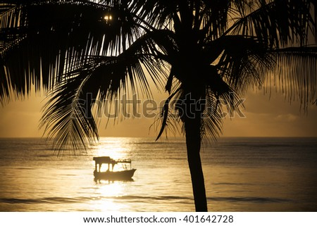 Boat at sunset, Kenya - stock photo