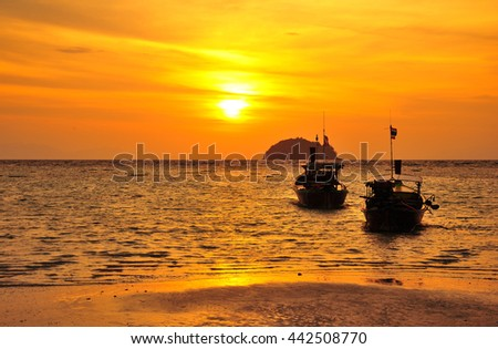 Boat at the Beach During Sunset in Thailand - stock photo