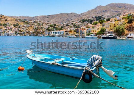 Boat at the harbor of Symi. Dodecanese, Greece, Europe - stock photo