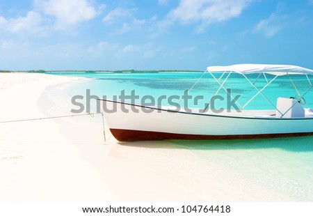 Boat at the tropical beach of Crasqui island, Los Roques - stock photo