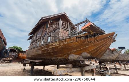 Boat awaiting restoration, Ayutthaya in Thailand. - stock photo