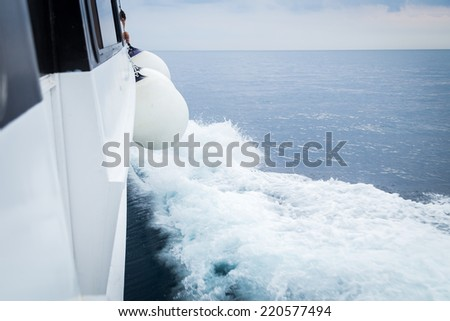 Boat bow sailing in blue Mediterranean sea in summer vacation.view of the sea from the boat before the storm.Yacht. Sailing. Yachting. Tourism. Sailing yacht boat on on ocean water. outdoor lifestyle - stock photo