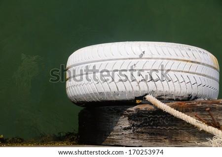Boat bumper old tire. - stock photo