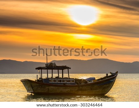 Boat calm before dawn as the sun slowly rise ... to express the rest of the season when fishermen fish on, languish waiting to be put to sea - stock photo