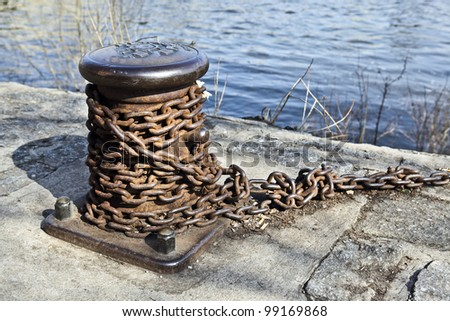 Boat chain and water - stock photo