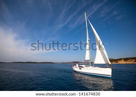 Boat competitor of sailing regatta - stock photo