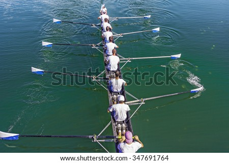 Boat coxed eight Rowers training rowing on the lake - stock photo