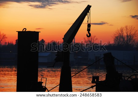 boat cran and sunset at Sava river in Belgrade, Serbia