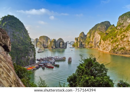 Boat cruise Junks and Floating village in Halong Bay, Vietnam.UNESCO World Heritage Site.
