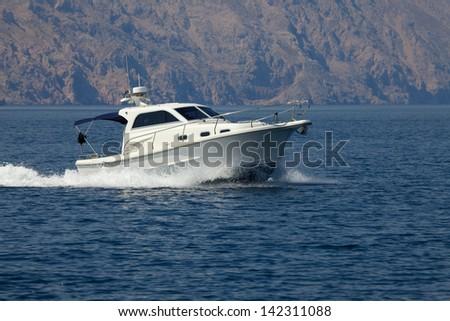 Boat cruising on the sea - stock photo