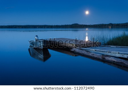 Boat Dock at a Moon-lit Lake - stock photo