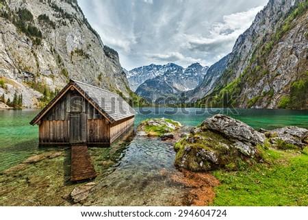 Boat dock hangar on Obersee mountain lake in Alps. Bavaria, Germany - stock photo