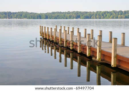 boat dock on a lake - stock photo