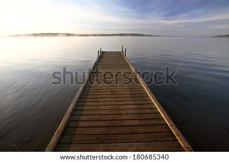 boat dock on a Saskatchewan lake - stock photo