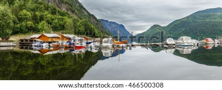 Boat dock on beautiful mountain lake in Norway.