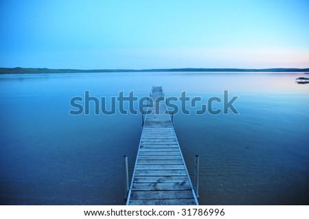 Boat dock overlooking popular tourist destination Glen Lake, in Glen Arbor, Empire Michigan. - stock photo