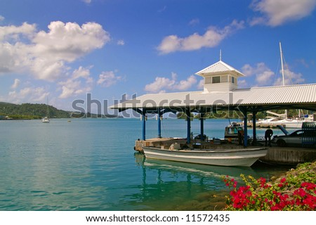 boat docked at a tropical harbor on a sunny day