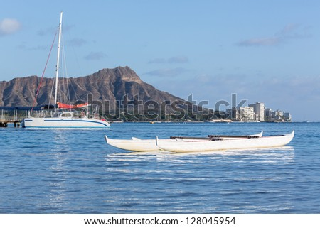 Boat docked in front of Diamond Head and Waikiki Beach area of Oahu in Hawaii - stock photo