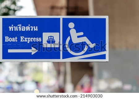 Boat Express Pier signboard showing Ramp Access Facilities for the Disabled, Bangkok,Thailand. - stock photo