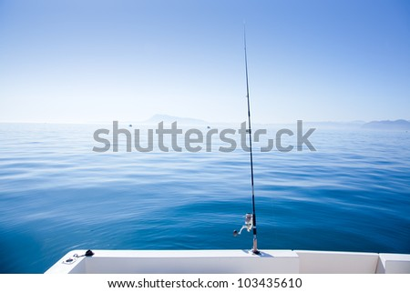 boat fishing rod in mediterranean blue sea in Spain - stock photo