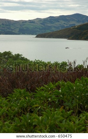 boat from afar - stock photo