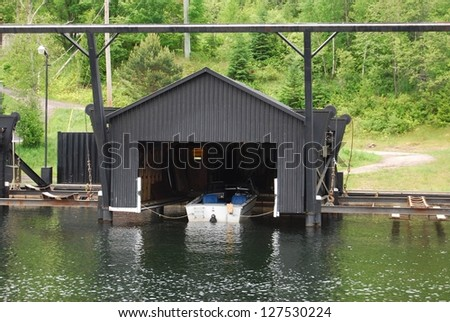 Red house under water malmo sweden stock photo 140345863 for Boat garage on water