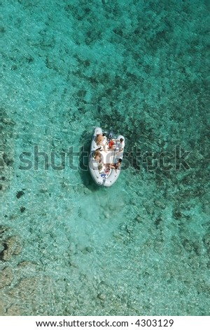 boat in clear coral waters