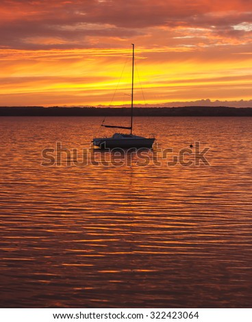 Boat in lake water in sunset time