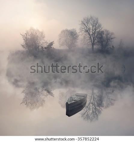Boat in the fog - stock photo