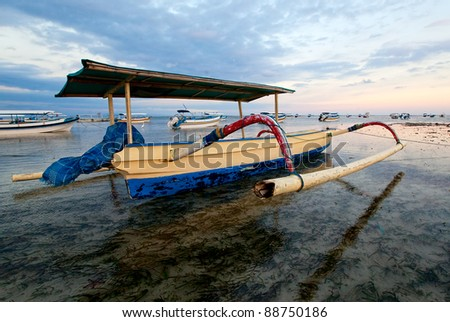 Boat in the night on Bali, Nusa Dua - stock photo
