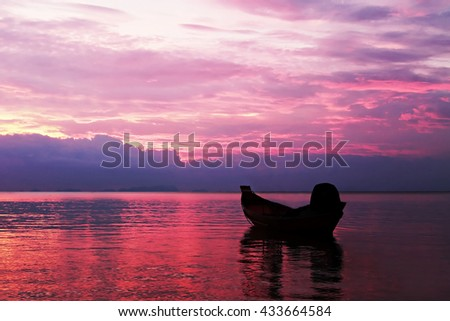 Boat in the sea silhouette on the sunset