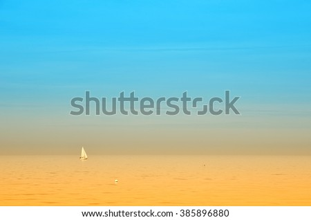 Boat in the sea with calm waters at sunset - stock photo