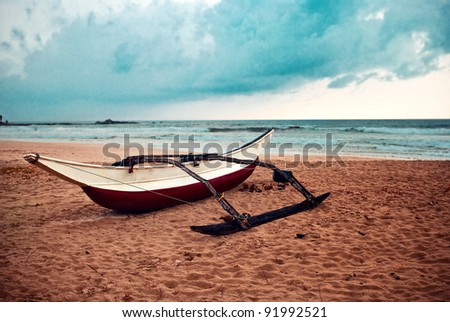 boat is in the sand on the beach - stock photo