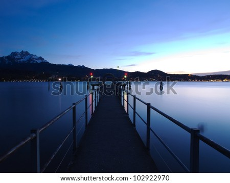 Boat jetty at dusk - stock photo