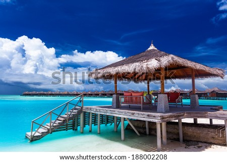 Boat jetty with steps into water on a tropical island of Maldives - stock photo