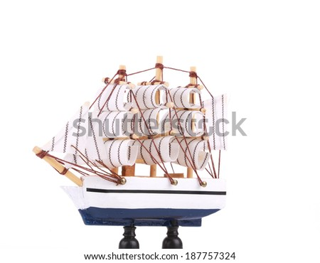 Boat model. Small wooden ship. Isolated on a white background.