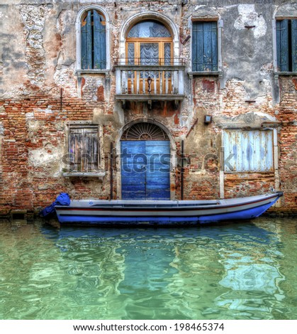 Boat Moored in a Canal in Venice - stock photo