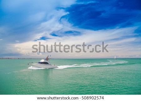 Boat off the coast of Italy. Azure sea