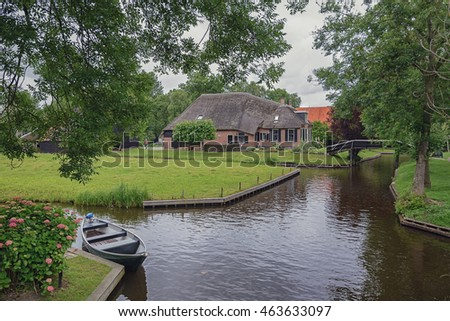 Boat on a canal in the Dutch village of Giethoorn.