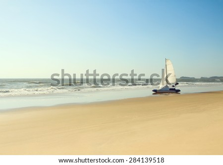 Boat on a deserted beach - stock photo
