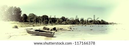 Boat on a gulf beach. Vintage stylization - stock photo