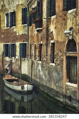 Boat on a Narrow Side Canal in Venice Italy