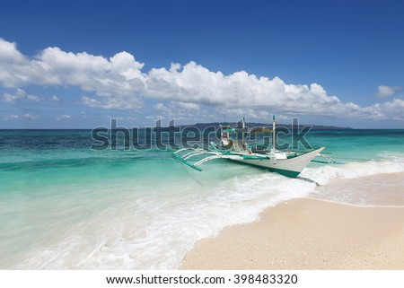 Boat on beach and tropical sea of Philippines at sunny day - stock photo