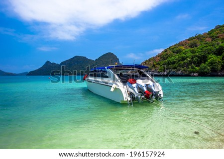 boat on beach of island in Thailand - stock photo