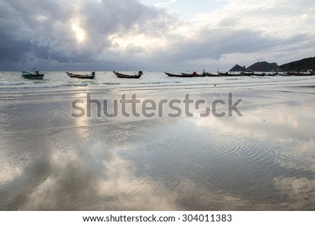 Boat on beach reflection in water -Tao Island ,Thailand