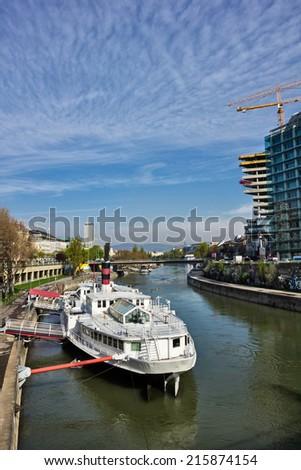 Boat on Danube river in Vienna Austria - stock photo