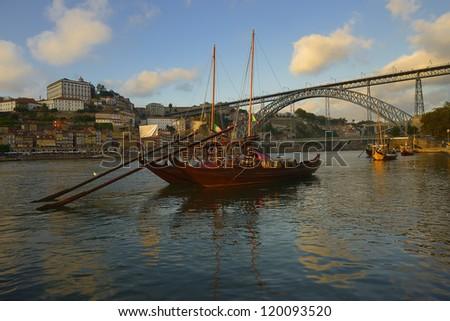 Boat on Douro river and Dom Luis I bridge in Porto. Portugal - stock photo