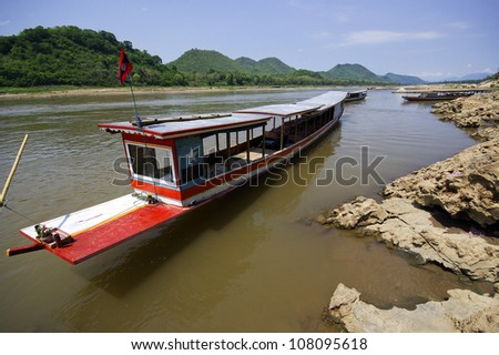 Boat on Mekong river, border crossing, checkpoint - stock photo