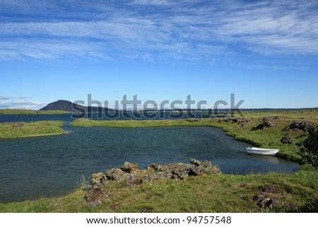 Boat on Myvatn Lake in northern Iceland - stock photo